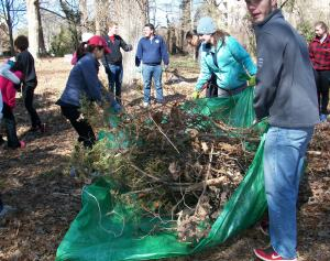 NCSU students help haul brush from the historic Oberlin Cemetery.